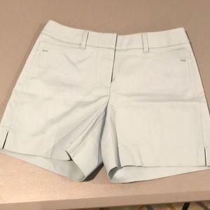 Pale green shorts